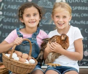 Photo of kids selling eggs
