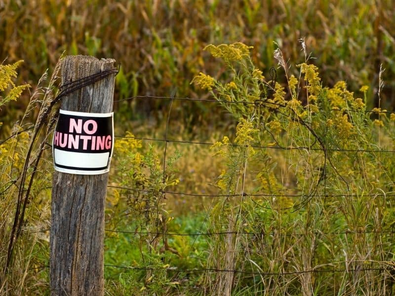 Photo of no hunting sign on fence post