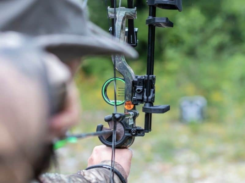 phot of a man shooting a bow